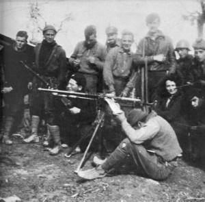 George Orwell as International Brigader in Spain, with the POUM militia at the Aragón front. Orwell is the tallest among the standing figures