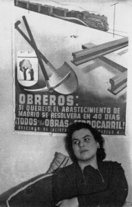 Muriel Rukeyser in front of a Spanish Civil War poster.
