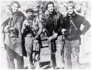 Just back from a mission behind Franco's lines, probably late 1937. From left to right: Bill Aalto, a Spanish guerrilla fighter, Alex Kunstlich, and Irv Goff.