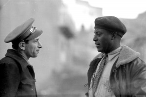 Abraham Lewis (r) of the Brigade Commissariat, with Chief of Auto Park Louis Secundy, Dec. 1937 (Tamiment Library, NYU, 15th IB Photo Collection, Photo # 11-1010)
