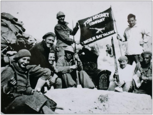 Members of the Lincoln Battalion Machine Gun Company on the Jarama Front, Spring 1937. Courtesy of Dave Smith who is holding the staff of the flag.
