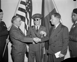 From left to right: Francis J. Gorman, President of the United Textile Workers of America; Lieut. Robert Raven, wounded and blinded in Spain; and Commander Paul Burns in Washington, D.C., Feb 12, 1938 for the First National Conference of the Veterans of the Abraham Lincoln Brigade. Wikipedia Commons.