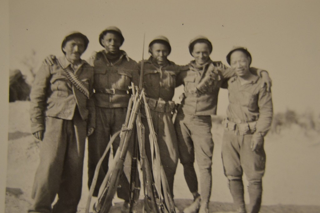 International volunteers in Spain. Left to right: a seaman from Chile; Sterling Rochester (USA); Artemio Luna (Philippines); Juan Santiago (Cuba); and Jack Shirai (Japan).