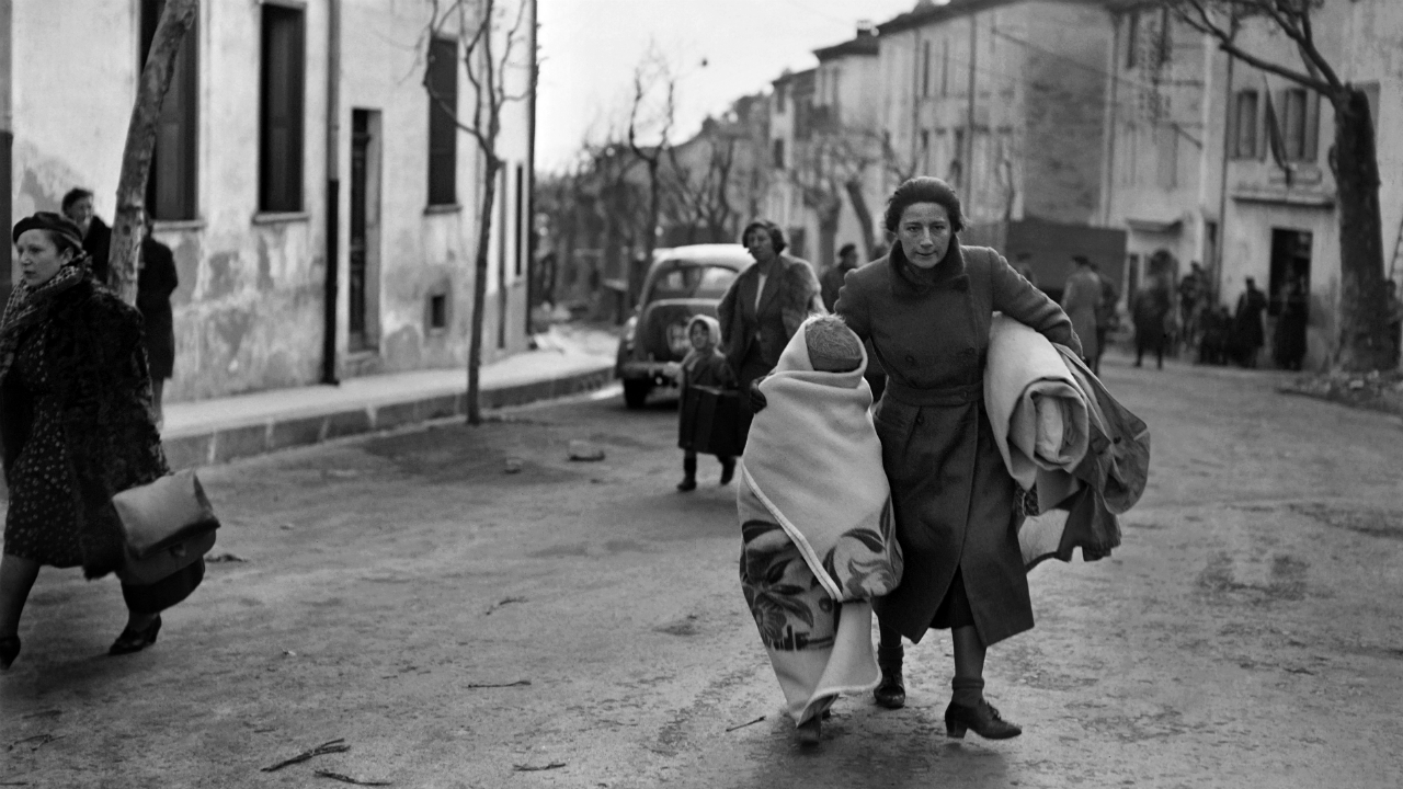 A photo dated February 1939 of a woman and her child arriving on foot in the southeastern French border town of Perthus. AFP