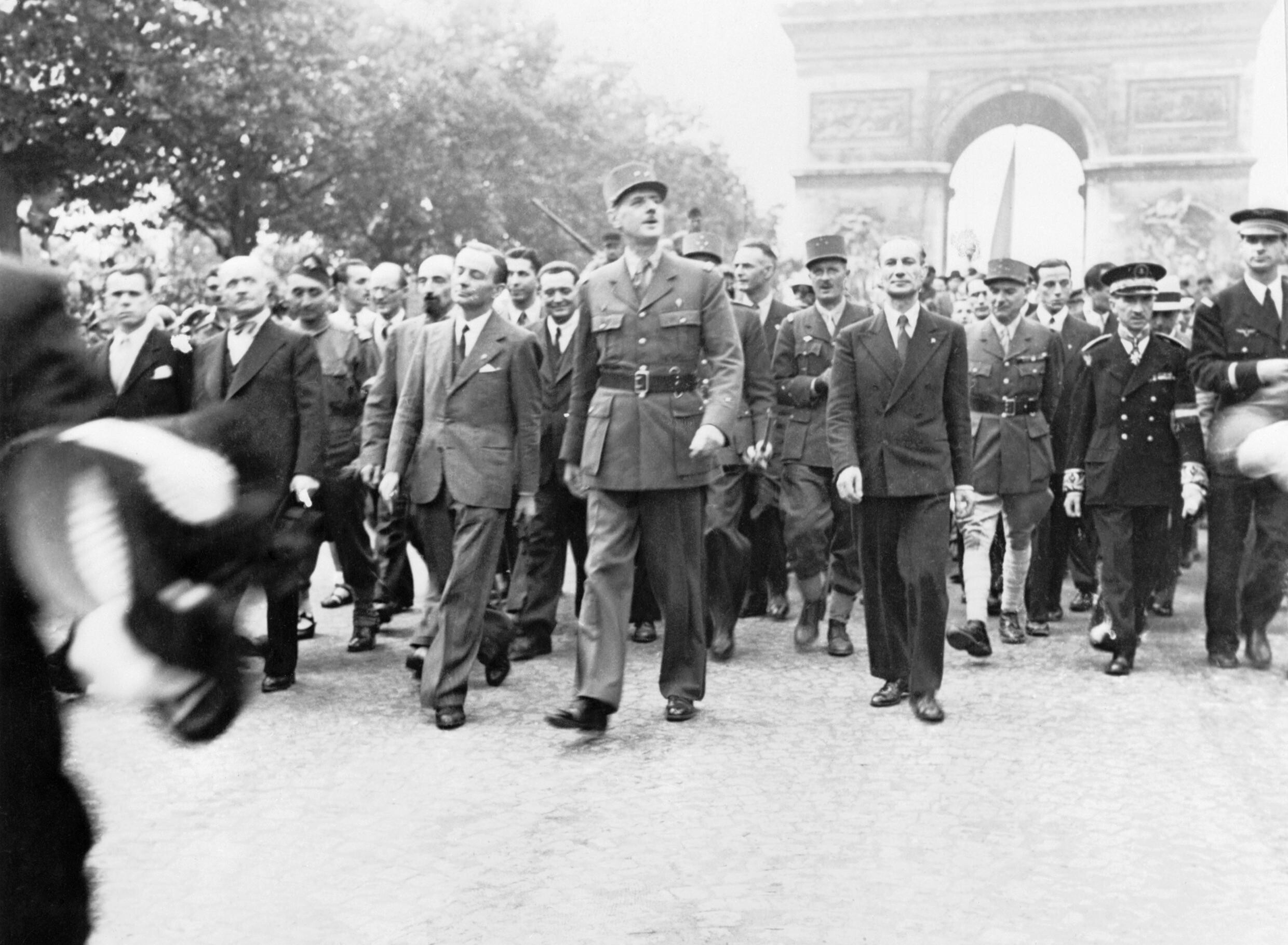 The Liberation of Paris, 25 - 26 August 1944. General Charles de Gaulle and his entourage set off from the Arc de Triomphe down the Champs Elysees to Notre Dame for a service of thanksgiving following the city's liberation in August 1944. London: Imperial War Museum. Public domain.