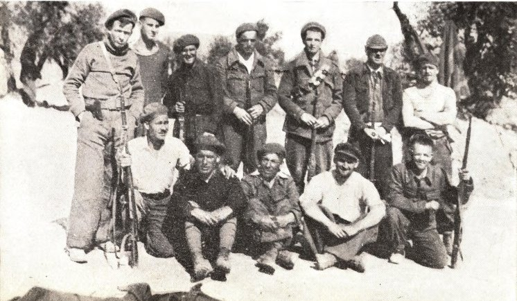 Irish volunteers in Spain: Eddie Flaherty, Company Commander, extreme left, standing. From the Book of the XV Brigade.