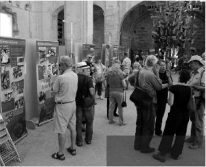 """The IBMT's """"Antifascistas"""" exhibition on show in the ruined church in Corbera d'Ebre, which has been preserved as a war memorial. The IBMT's new plaque is located next to the church and overlooks the Ebro battlefield."""