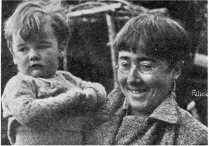 """SMILING: A rare photo of Felicia Browne and unidentified child. This one was published posthumously in September 1949 in Spain Today, the magazine of the International Brigade Association. Felicia Browne's sketches will feature is the exhibition """"Conscience and Conflict: British Artists and the Spanish Civil War"""" at the Pallant House Gallery in Chichester from 8 November to 15 February 2015 and afterwards at the Laing Art Gallery, Newcastle upon Tyne, in the spring of next year."""
