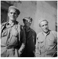 Joseph Dougher, Commissar, Mackenzie-Papineau, Company 3, Albert Harris, Brigade Intendencia, and Wally Sabatini, Political Commissary Mackenzie-Papineau, Company 3, October 1937. The 15th International Brigade Photographic Unit Photograph Collection; ALBA Photo 11; ALBA Photo number 11-0728.