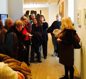 "The interested audience looks at an early Motherwell work inspired by a Lorca poem, ""Death at 5 in the Afternoon,"" which was the inspiration for the Elegies series.  In the back row are Abby London Crawford, the family of VALB Ernest Amatniek and Jane Shufer, daughter of VALB Max Shufer."