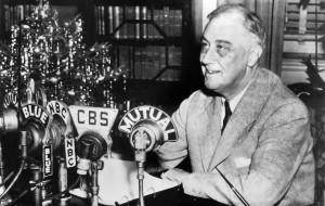 Franklin D. Roosevelt at his home in Hyde Park, New York, delivering a national radio address, 24 December, 1943. National Archives and Records Administration, Public Domain.