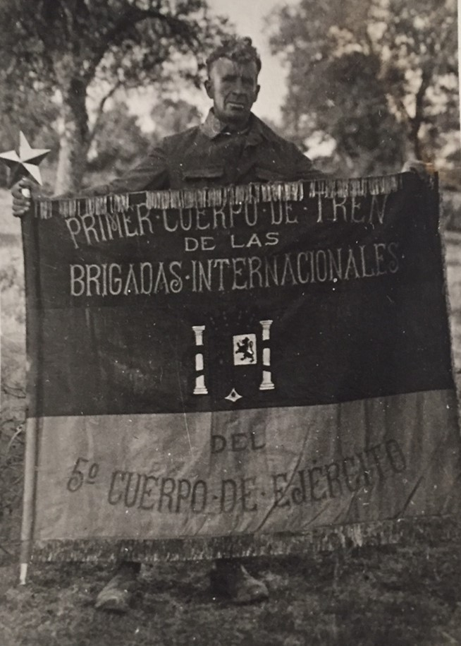 Mark Thornton with the Flag of the Fifth Army Corps Primer Cuerpo de Tren, 1938, Courtesy Georgia Wever.