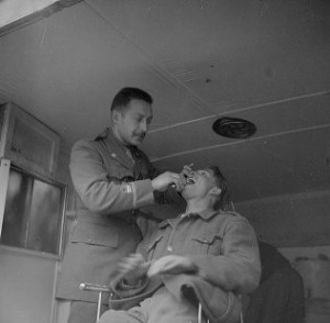 "Dental Wagon at work, ""Doc"" Jack Klien, February 1938. The 15th International Brigade Photographic Unit Photograph Collection ; ALBA Photo 11; ALBA Photo number 11-0865. Tamiment Library/Robert F. Wagner Labor Archives. Elmer Holmes Bobst Library, 70 Washington Square South, New York, NY 10012, New York University Libraries"