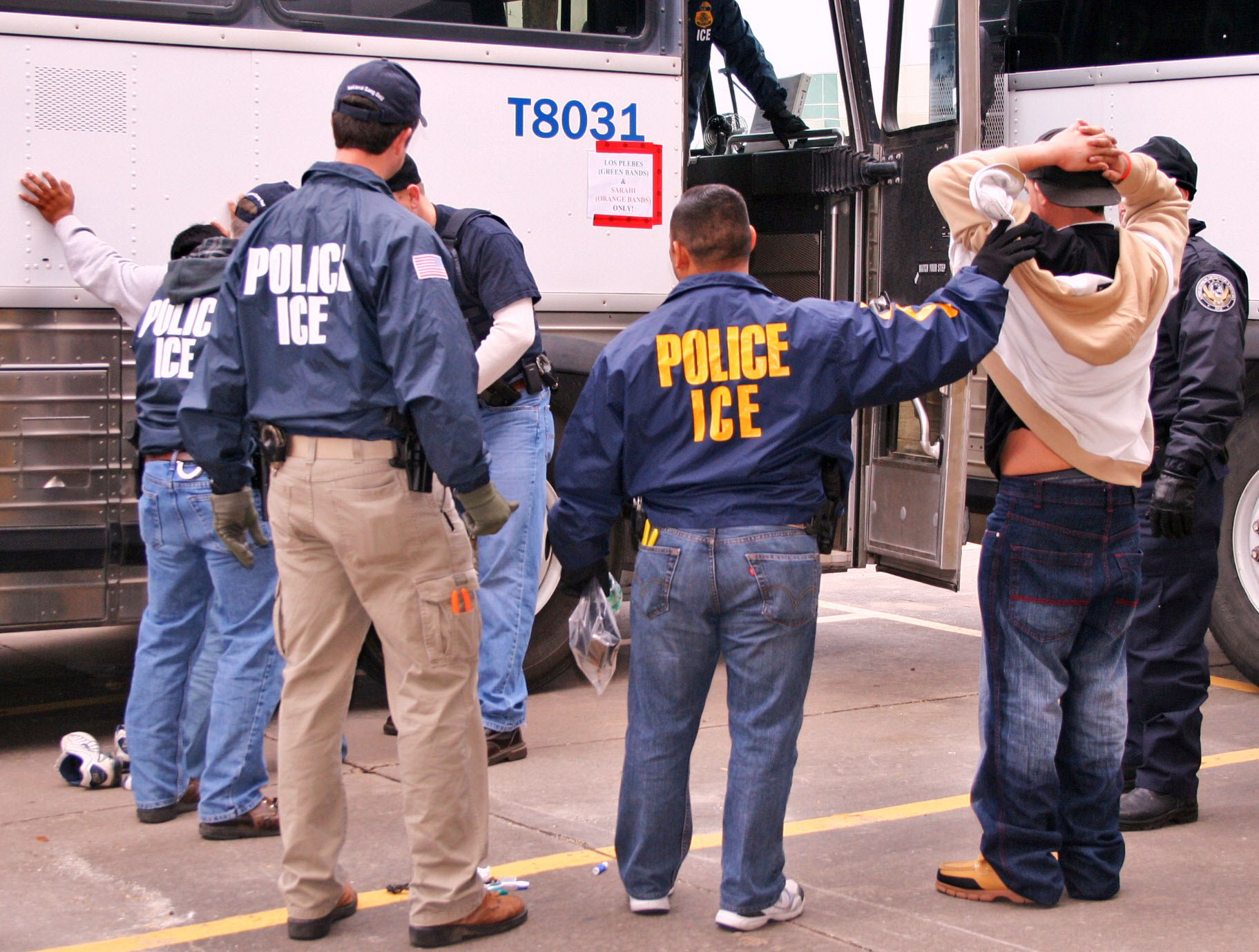ICE Special Agents (U.S. Immigration and Customs Enforcement) arresting suspects during a raid. Houston, 2010. Photo Courtesy of ICE