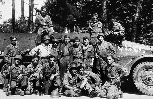 "The crew of the halftrack ""Guadalajara Nº 2"" & others in Paris shortly after the liberation. Archivo Histórico del Partido Comunista de España."