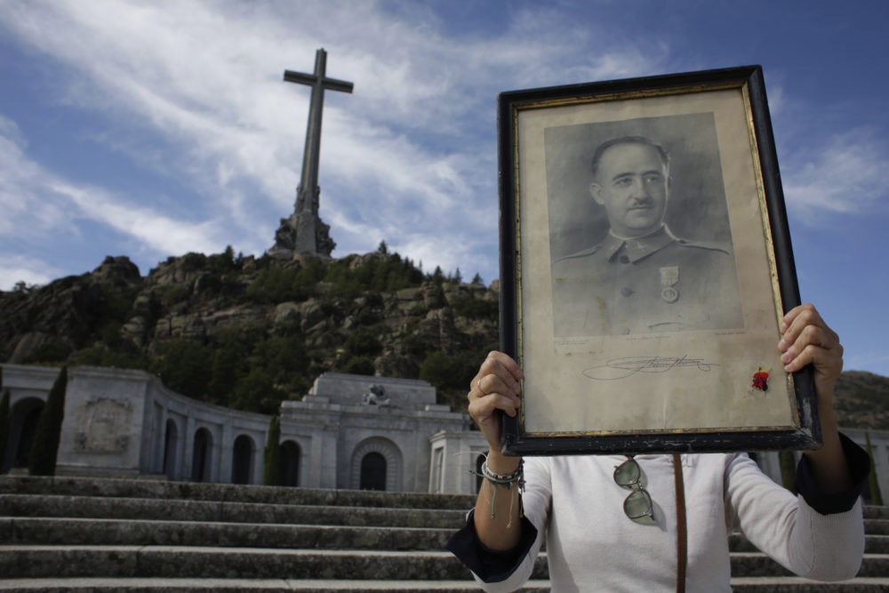 A visitor holds a portrait of Francisco Franco at the Valley of the Fallen mausoleum on the outskirts of Madrid. (Alfonso Ruiz/AP)